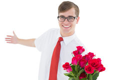 Nerdy hipster offering bouquet of roses Royalty Free Stock Image