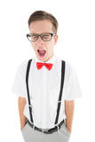 Nerdy hipster yawning in suspenders and bow tie Royalty Free Stock Photo