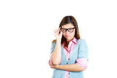 Nerdy insecure young girl with glasses, nervous looking at camera Royalty Free Stock Image