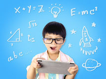 Nerdy Kid is getting Education from tablet Stock Images