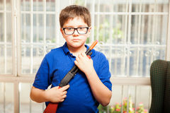 Nerdy kid with a toy gun Royalty Free Stock Photo
