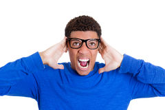 A nerdy looking young student wearing glasses yelling out in frustration Royalty Free Stock Photo