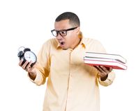 Nerdy man with books and clock Stock Images