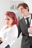 Nerdy man bothering an intern woman Royalty Free Stock Photography