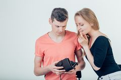 Nerdy man is trying to hide money from his wife because she want to spend it all stock photography