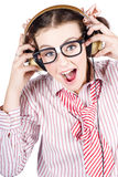 Nerdy Retro Schoolgirl Raving To Music On White Stock Image