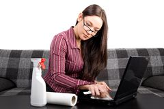 Nerdy woman cleaning her computer Stock Image