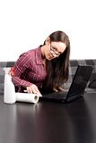 Nerdy woman cleaning her computer Stock Photography