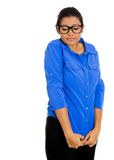 Nerdy woman. Closeup portrait of a young nerdy looking woman with big glasses, very timid suspicious shy and anxious looking away down isolated on white Stock Image