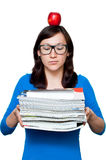 Nerdy young female with books Stock Photography