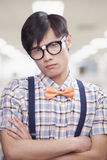Nerdy Young Man with Glasses and Bowtie Looking At Camera Stock Photos