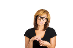 Nerdy young woman who is looking away in guilt Stock Photos
