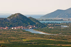 Neretva valley with hills and sea in background. Beautiful Neretva valley in southern Croatia with Adriatic sea in background Royalty Free Stock Photo