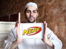 Nerf toy brand logo. Logo of nerf toy brand on samsung tablet holded by arab muslim man. NERF is a toy brand created by Parker Brothers and currently owned by stock image