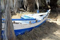 Nerja, Andalusia- old boat. Awesome old abandoned boat among the palms - Nerja-Andalusia-Spain Royalty Free Stock Photo