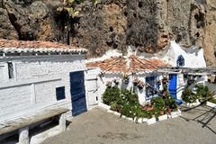 Nerja-Andalusia-Spain rock house. Incredible house in the rock on the beach among plants. Nerja-Andalusia-Spain Stock Photo