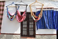 Nerja-Andalusia-Spain street shop. Charming small street shop with colorful hammocks.  Nerja-Andalusia-Spain Stock Image