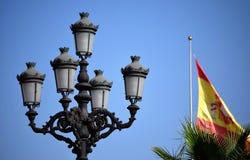 Nerja, lampada di via e bandiera Immagine Stock
