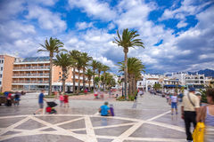 Nerja promenade - Balcón de Europa. Photograph of tourists walking on a promenade called Balcon of Europe in Nerja town, Andalusia, Spain royalty free stock photo