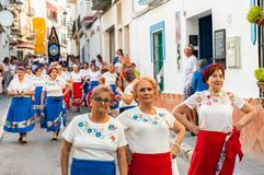 NERJA, SPAIN - JULY 16, 2018 annual parade in the coastal Andalusian town on the occasion of a pilgrimage with the sculpture royalty free stock image