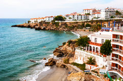 Nerja, Spain. Little touristic town Nerja in Costa del Sol, Andalusia. Spain. It has many restaurants, bars and cafes. Aerial view of the beach royalty free stock photo