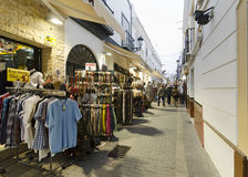 Nerja, Spain. NERJA, MALAGA, SPAIN - APRIL 17, 2013:  People strolling at sunset along the pedestrian area full by entertainment facilities in Nerja, Malaga Stock Image