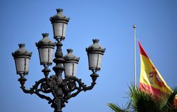 Nerja, street lamp and flag. Beautiful street lamp and Spain flag in background Stock Image