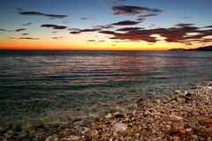Nerja sunset, sea view, spain. Beach view at Sunset of nerja city in spain. located near malaga. nobody to be recognized stock photography