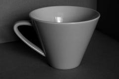 Nero e con la tazza Immagine Stock