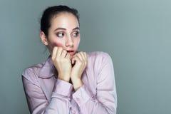 Nervöse Frau stockbilder
