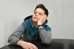 Nerved boy. Portrait of a depressed teenage boy Stock Image