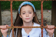 Nerved girl. Cute girl  at the playground, looking nerved Stock Photography