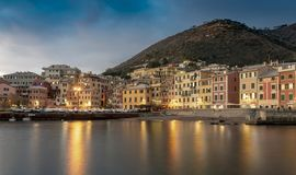 Nervi, Genoa at night with reflections on the bay royalty free stock photography