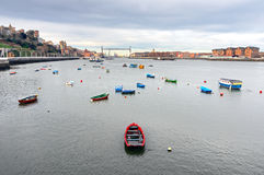 Nervion river with boats and hanging bridge Stock Images