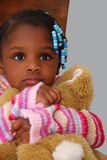 Nervous. An adorable girl holds her stuffed animal tight as she stares off in the distance Royalty Free Stock Image