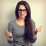 Nervous angry young woman in glasses with aggressive negative fa Royalty Free Stock Photos