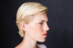 Nervous blonde woman Royalty Free Stock Photography