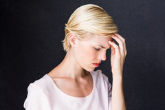 Nervous blonde woman. On black background stock photo
