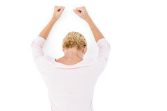 Nervous blonde woman leaning against the wall. On white background Stock Photography