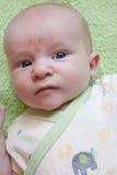 Nervous Blue Eyed Baby Stock Photo