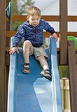Nervous boy. At the top of a slide Stock Photography