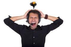 Nervous breakdown. Man with headphones having nervous breakdown Royalty Free Stock Image