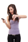 Nervous brunette woman shouting to a mobile Stock Images