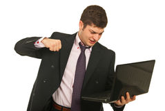 Nervous business man fist  laptop Stock Image