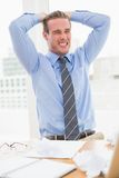 Nervous businessman with hands on head Stock Image