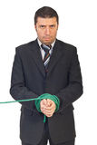 Nervous businessman with hands tied Stock Image