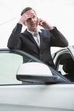 Nervous businessman on the phone Stock Photos