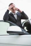 Nervous businessman on the phone Stock Photos