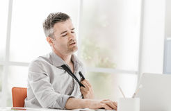 Nervous businessman in the office Stock Photo