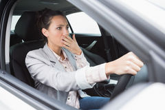 Nervous businesswoman crashing her car. During her trip Royalty Free Stock Photography